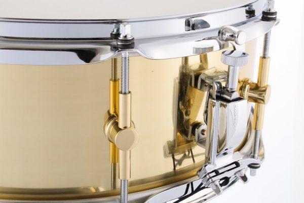 The Brass Snare Drum Strainer